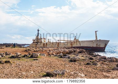 Abandoned ship on the rocks near the shore. Cyprus