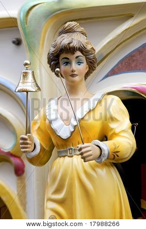 Female Figure Ringing A Bell On A Barrel Organ