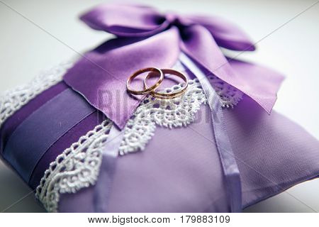 Weddings ring on the serenity pillow on a white background