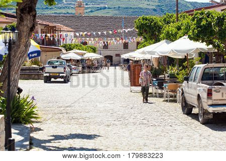 CYPRUS, OMODOS - 10 MAY 2012: View on street in Omodos village, Cyprus