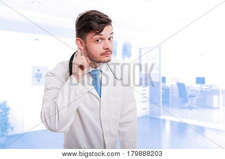 Doctor Holds His Hand Near His Ear