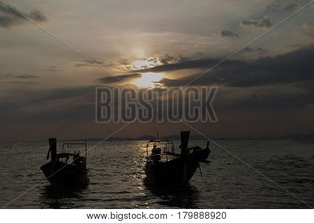 Traditional thai longtail boat at sunset on the Beach. Thailand Krabi province