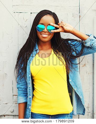 Fashion Portrait Pretty Smiling Young African Woman In A Sunglasses Is Having Fun At City
