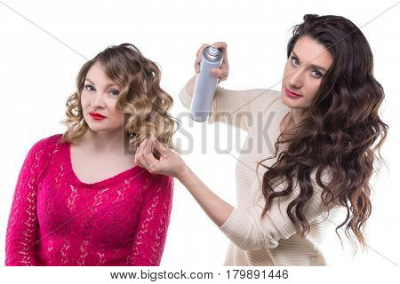 Hairstylist with hairspray and client woman on white background