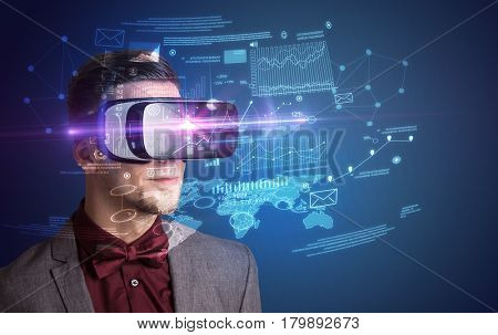 Amazed businessman with virtual reality business plan in front of him