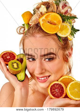 Hair mask from fresh fruits on woman head. Girl with beautiful face hold ingredient for homemade organic skin and hair therapy. Concept of healthy and beauty hair and skin.
