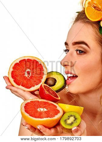 Hair and facial mask from fresh fruits for woman concept. Girl with beautiful face holds halves of grapefruit and avocado for homemade organic skin therapy on white isolated.