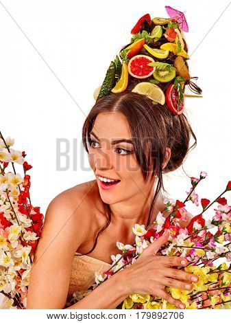 Hair mask from fresh fruits on woman head. Girl with beautiful face and hairstyle in spring flowers as symbol of healthy diet and lifestyle or organic skin care and body therapy on isolated.
