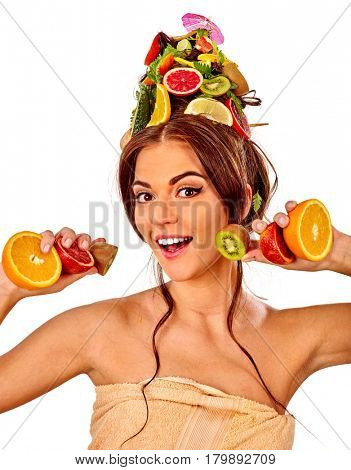 Hair mask from fresh fruits on woman head. Girl with beautiful face and hairstyle hold halves of orange for skin and body therapy. Female bare shoulders. Concept of healthy and beauty on isolated.