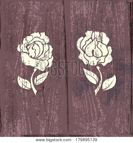Knurl of roses on old wooden background