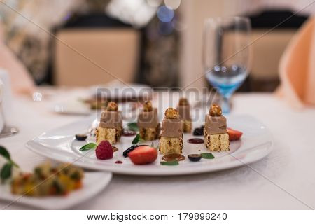 Appetizing food on a banquet table. Snacks