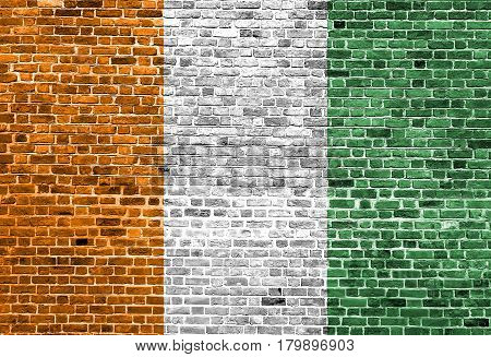 Flag of Cote d'ivoire painted on brick wall, background texture