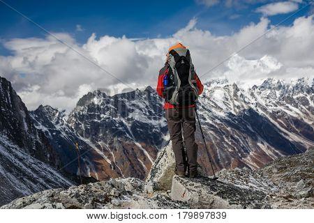 Trekker goes down fron Larke La pass on Manaslu circuit trek in Nepal