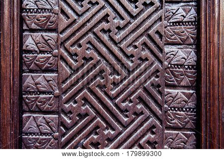 Details of a fine wood carving art. Carved wooden pattern