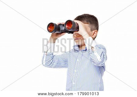 Young Caucasian cute boy using big binoculars