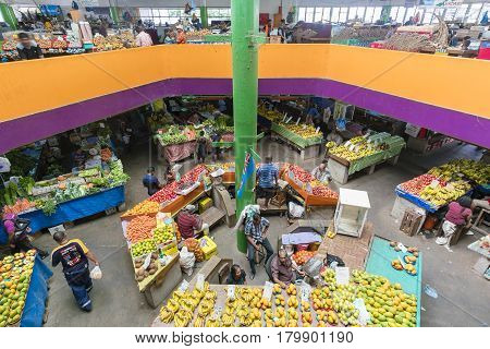 Suva, Fiji - Mar 24, 2017: View of people selling local produce at the grocery stores in Suva Market in Fiji
