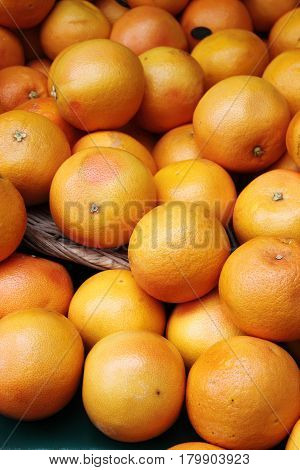 Heap of oranges for sale in a greengrocery