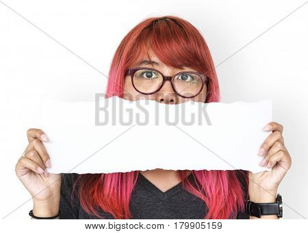 Young adult asian girl holding blank paper cover her mouth