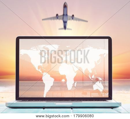 Modern laptop on blue wooden table with blank screen at tropical beach. Elements of this image furnished by NASA