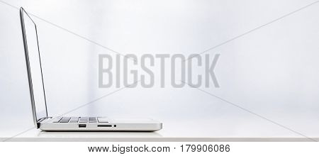 Modern laptop computer on white background, rear view