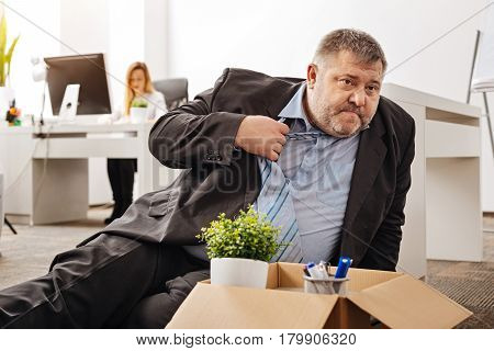 Just lie here for a sec. Corpulent unhealthy emotional guy not feeling well after hearing the news about his dismissal and having taking a sit