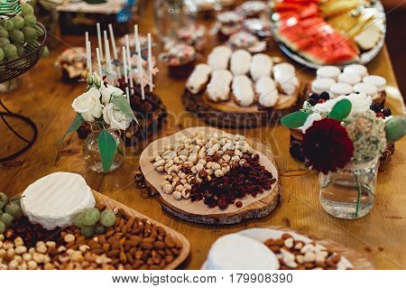 Candy Bar. Delicious sweet buffet with cupcakes. Sweet holiday buffet with cupcakes and other desserts.Table with sweets, candies, dessert