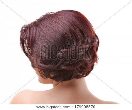 Young woman with beautiful haircut on white background