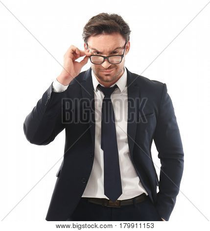 Handsome young man posing with glasses on white background