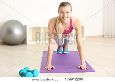 Diet concept. Young beautiful woman training in gym