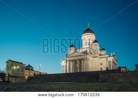 Helsinki Cathedral or St Nicholas Church on the empty Senate square against evening sky.