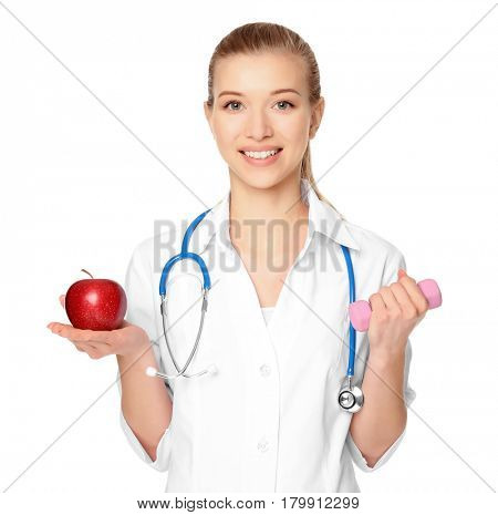 Diet concept. Female nutritionist with apple and dumbbell on white background