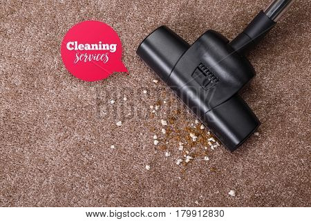 Vacuuming carpet with vacuum cleaner. Dirt on the rug. Housework service. Close up of the head of a sweeper cleaning device.