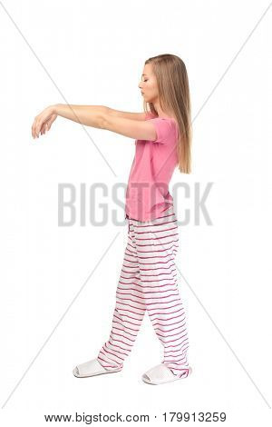 Young sleepy woman suffering from somnambulism on white background