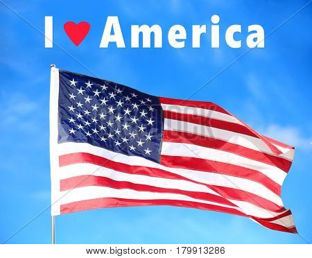 Text I LOVE AMERICA and USA flag on sky background
