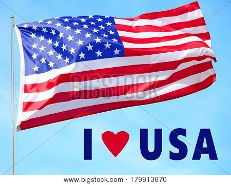 Text I LOVE USA and American flag on sky background