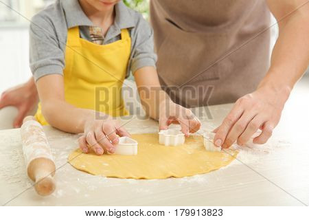 Dad and son cooking at home, closeup