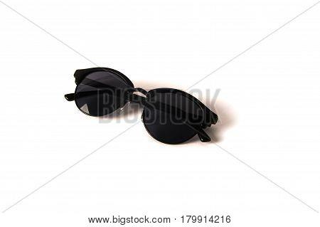 women black round sunglasses isolated on white.