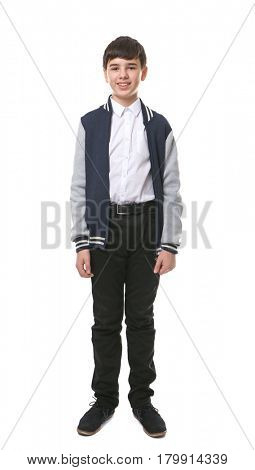 Cute boy in school uniform on white background