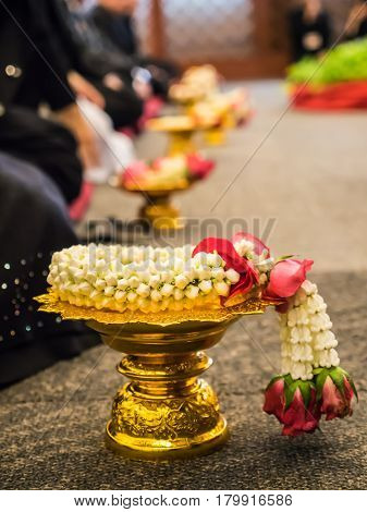 Garland, lei of flowers in tray for worship