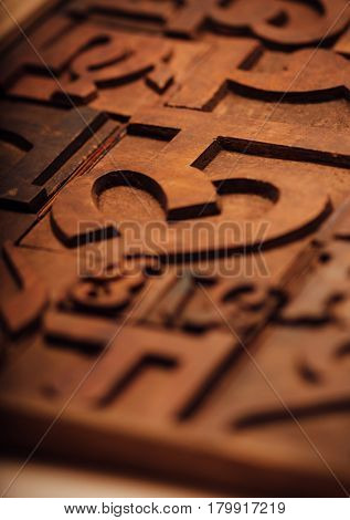 Weathered wooden alphabets of an Indian language. Traditional letter press printing blocks background.
