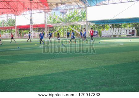 Artificial grass football field green blur close up