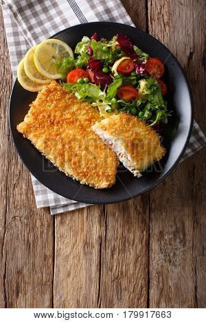 Fried Fish Fillet In Breading And Fresh Vegetable Salad Close-up. Vertical Top View