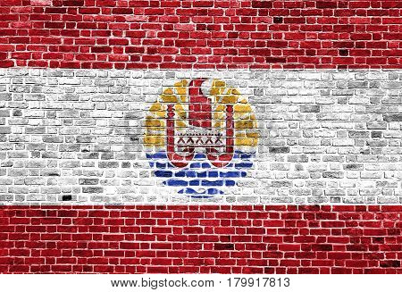Flag of French Polynesia painted on brick wall, background texture