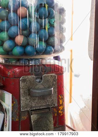 Antique petite dispenser gumball machine, capsule toy for kids