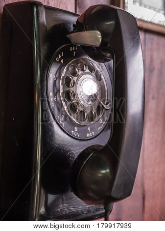 Rotary phone dial, antique telephone on wall
