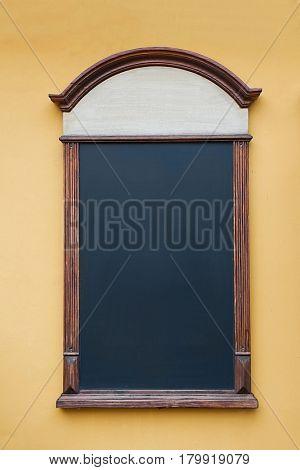 Empty menuboard on a wall