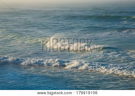 Waves of incoming tide on the ocean