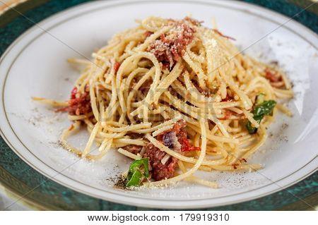 Traditional Italian Spaghetti aglio e olio with corned beef food background.