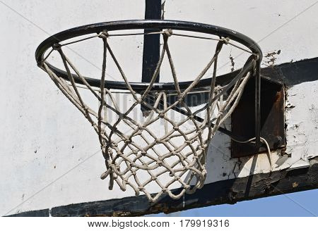 Closeup of a basketball hoop and wooden board in the sport playground