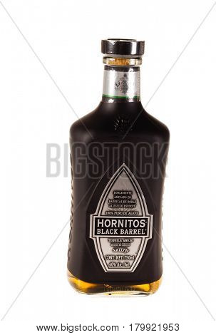 Colbert, WA - April 1, 2017: Hornitos Black Barrel Mexican tequila isolated on white, illustrative editorial